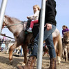 Jeff Krage – For the Kane County Chronicle<br /> Mila Jordan, 4, of Batavia rides a pony during Saturday's Easter celebration on the campus of Mooseheart.<br /> Mooseheart 3/30/13