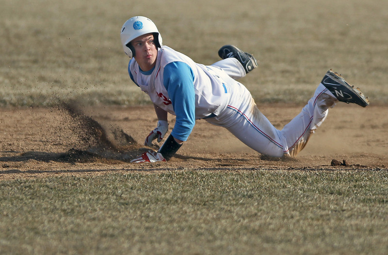 Sarah Nader - snader@shawmedia.comMarian Central's Edgar Ross is out as he slides to second base  during Wednesday's game against Montini on April 4, 2013.
