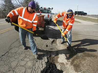 H. Rick Bamman - hbamman@shawmedia.com McHenry public works crew members, Pedro Padro and Clint Greve patching potholes along Crystal Lake Ave in McHenry.