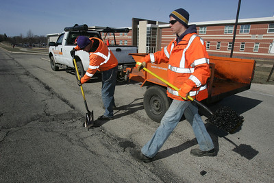 H. Rick Bamman - hbamman@shawmedia.com McHenry public works crew Pedro Padro and Clint Greve  patch pot holes along Crystal Lake Ave in McHenry.
