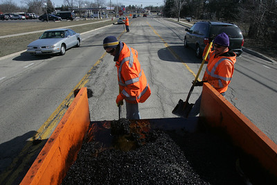 H. Rick Bamman - hbamman@shawmedia.com McHenry public works crew Clint Greve and Pedro Padro work patching potholes along Crystal Lake Ave in McHenry.
