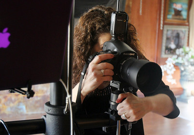Sarah Nader - snader@shawmedia.com Photographer Audrey Wancket checks her camera equipment in preparation of a portrait shoot at her Spring Grove studio on Wednesday, April 3, 2013. Wancket Studios specializes in family, children and high school senior portraits. She's been in business since 1986 and recently won a Cannon Image Excellence award and has been elected onto the board of directors for the Professional Photographers of America.
