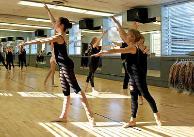 Girls in Stephanie Nowak's ballet class work hard during their last session before Spring Break.