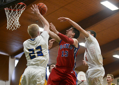 Josh Peckler- For Northwest Herald Dunde-Crown's Dylan Kissack (13) tries to put up a shot while being guarded by Johnsburg's Kevin Dombroski (23) and Mchenry's Damian Zalewski (3) during the first half of the Mchenry County Area All-Star game at Alden-Hebron High School Sunday, April 21, 2013.
