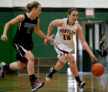 Josh Peckler- For Northwest Herald Huntley's Haley Ream (12) drives the ball down court while being guarded by Woodstock North's Samantha Ahr during the second half of the Mchenry County Area All-Star game at Alden-Hebron High School Sunday, April 21, 2013.