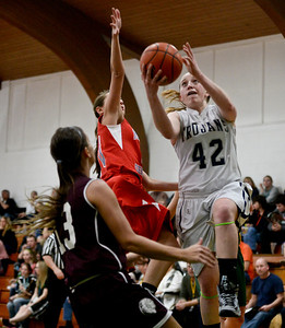 Josh Peckler- For Northwest Herald Cary-Grove's Olivia Jakubicek (42) goes up for a layup while being guarded by several defenders during the second half of the Mchenry County Area All-Star game at Alden-Hebron High School Sunday, April 21, 2013.