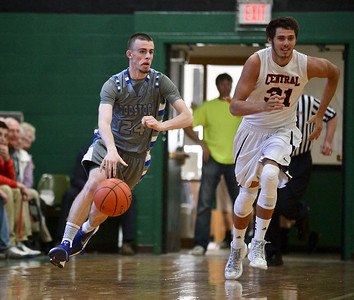 Josh Peckler- For Northwest Herald  Woodstock's Jordan Turner dribbles the ball down court alongside Crystal Lake Central's Kyle Fleck during the first half of the Mchenry County Area All-Star game at Alden-Hebron High School Sunday, April 21, 2013.