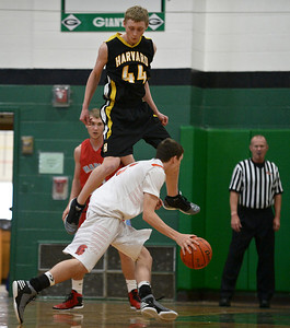 Josh Peckler- For Northwest Herald Harvard's Erik Finke flies through the air while guarding Mchenry's Damian Zalewski during the first half of the Mchenry County Area All-Star game at Alden-Hebron High School Sunday, April 21, 2013.