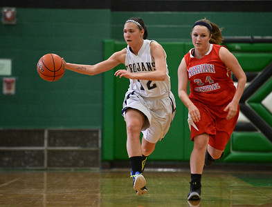 Josh Peckler- For Northwest Herald Cary-Grove's Joslyn Nicholson (12) tries to hold onto the ball while running along with Marian Central's Katie Anderson during the second half of the Mchenry County Area All-Star game at Alden-Hebron High School Sunday, April 21, 2013.