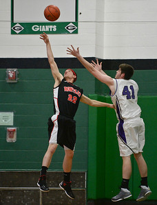 Josh Peckler- For Northwest Herald Huntley's Jake Wagner (22) and Hampshire's Shane Hernandez battle for a rebound during the first half of the Mchenry County Area All-Star game at Alden-Hebron High School Sunday, April 21, 2013.