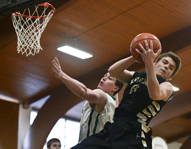 Josh Peckler- For Northwest Herald Grayslake North's Nick Carmody (0) grabs a rebound during the first half of the Mchenry County Area All-Star game at Alden-Hebron High School Sunday, April 21, 2013.