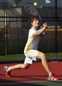 Sarah Nader - snader@shawmedia.com Jacobs' Michael Bujacz returns a ball while competing in a doubles match against Prairie Ridge in Algonquin on Wednesday, April 24, 2013.