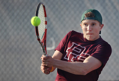 Sarah Nader - snader@shawmedia.com Prairie Ridge's Mitch Mohr returns a serve while competing in a doubles match against Jacobs in Algonquin on Wednesday, April 24, 2013.