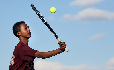 Sarah Nader - snader@shawmedia.com Prairie Ridge's Imraan Alas returns a ball while competing in a singles match against Jacobs in Algonquin on Wednesday, April 24, 2013.