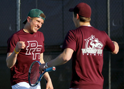 Sarah Nader - snader@shawmedia.com Prairie Ridge's Mitch Mohr (left) and Ross Carpenter celebrate a win while competing in a doubles match against Jacobs in Algonquin on Wednesday, April 24, 2013.