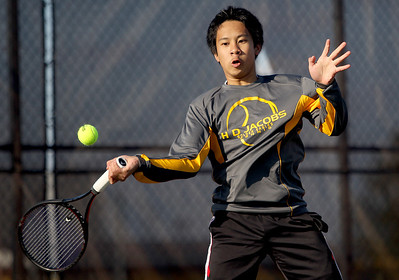 Sarah Nader - snader@shawmedia.com Jacobs' Kendrick Chong returns a ball while competing in a singles match against Prairie Ridge in Algonquin on Wednesday, April 24, 2013.