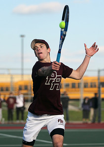 Sarah Nader - snader@shawmedia.com Prairie Ridge's Ross Carpenter returns a ball while competing in a doubles match against Jacobs in Algonquin on Wednesday, April 24, 2013.