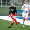 Batavia's Alexis Bryl (7) kicks the ball to a teammate during their game at Geneva Tuesday.