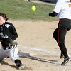 Monica Maschak - mmaschak@shawmedia.com<br /> Hayley Contorno, with Kaneland, misses a pass to tag out DeKalb's Jessica Townsend at first base during a game at DeKalb High School on Thursday, April 25, 2013. The Knights beat the Barbs 4-3.