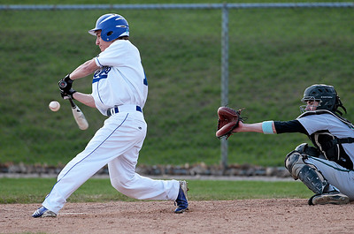 Kyle Grillot - kgrillot@shawmedia.com   Woodstock sophomore John Kruse swings at the ball during the second inning against Woodstock North at Emricson Park on Friday, April 26, 2013.