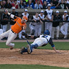 St. Charles East's Nicholas Erickson (left) scores in the 3rd inning against the St. Charles North at Fifth Third Bank Ballpark in Geneva, IL on Monday, April 29, 2013 (Sean King for Shaw Media)