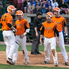 St. Charles East players celebrate after scoring 3 runs in the 3rd inning against the St. Charles North at Fifth Third Bank Ballpark in Geneva, IL on Monday, April 29, 2013 (Sean King for Shaw Media)