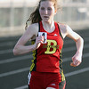 Jeff Krage – For the Kane County Chronicle<br /> Batavia's Grace Ball competes in the 3200 meter run during Friday's Kane County Girls Track Meet at Geneva High School.<br /> Geneva 4/26/13