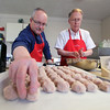 Jeff Krage – For Shaw Media<br /> Lee Kolodziej, left, of St. Charles and Bo Smith of Geneva work on preparing meatballs for Sunday's free spaghetti dinner at St. Charles Episcopal Church.<br /> St. Charles 4/28/13