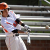 Jeff Krage – For the Kane County Chronicle<br /> St. Charles East's Adam Rojas swings at a pitch during game one of Saturday's doubleheader against Geneva at St. Charles East.<br /> St. Charles 4/27/13