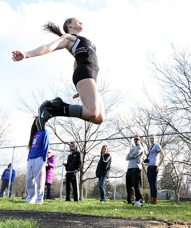 Jeff Krage – For the Kane County Chronicle<br /> Kaneland's Lauren Zick competes in the long jump during Friday's Kane County Girls Track Meet at Geneva High School.<br /> Geneva 4/26/13