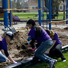 Volunteers from Kohl's spread mulch Saturday morning as part of a Go Green initiative at Mooseheart Child City and School.