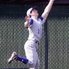 Jeff Krage – For the Kane County Chronicle<br /> Geneva center fielder Bobby Hess makes a running catch during game one of Saturday's doubleheader at St. Charles East.<br /> St. Charles 4/27/13