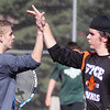 Jeff Krage – For the Kane County Chronicle<br /> St. Charles East's George Spoerl, right, congratulates doubles partner Matt McCarthy after winning a second set tie breaker Saturday during a match against Glenbard West at West Aurora High School.<br /> Aurora 4/27/13