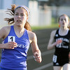 Jeff Krage – For the Kane County Chronicle<br /> Geneva's McKenzie Altmayer competes in the 3200 meter run during Friday's Kane County Girls Track Meet at Geneva High School.<br /> Geneva 4/26/13