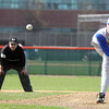 Jeff Krage – For the Kane County Chronicle<br /> Geneva's Jordan Touro pitches with a runner in scoring position in the second inning of game one of Saturday's doubleheader at St. Charles East.<br /> St. Charles 4/27/13
