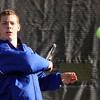 Jeff Krage – For the Kane County Chronicle<br /> Marmion Academy's John King hits a return during Saturday's tennis tournament at West Aurora High School.<br /> Aurora 4/27/13