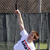 Jeff Krage – For the Kane County Chronicle<br /> St. Charles East's Justin Bowman serves during Saturday's tennis tournament at West Aurora High School.<br /> Aurora 4/27/13