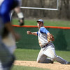 Jeff Krage – For the Kane County Chronicle<br /> Geneva first baseman Anthony Bragg looks to make a throw to the pitcher after fielding a ground ball during game one of Saturday's doubleheader at St. Charles East.<br /> St. Charles 4/27/13