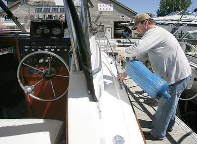 "H. Rick Bamman -hbamman@shawmedia.com  At the Port Barrington Marina, Thor Forsberg of Barrington prepares to take his 1973 Trojan boat ""Hagar IV"" out on the Fox River Friday, May 24, 2013."