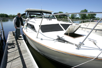"H. Rick Bamman -hbamman@shawmedia.com  Thor Forsberg of Barrington cleans up his 1973 Trojan boat ""Hagar IV"" before leaving the Port Barrington Marina for a short trip on the Fox River. Memorial Day is the unofficial start of the boating season along the Fox River."