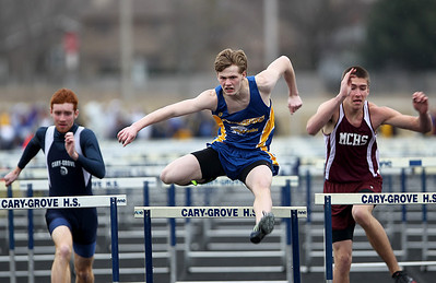 Sarah Nader - snader@shawmedia.com Cary-Grove's Michael Saxon (left), Johnsburg's Sam Blankenship and Marengo's Nick Simons compete in 110 high hurdles during Saturday's Al Bohrer Invitational Track Meet At Cary High School on April 6, 2013.