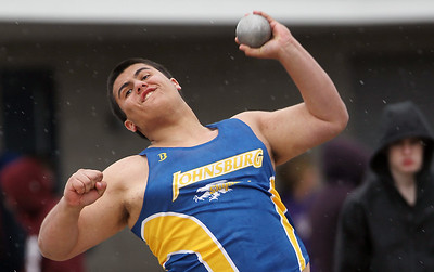 Sarah Nader - snader@shawmedia.com Johnsburg's Zach Kinney competes in shot put during Saturday's Al Bohrer Invitational Track Meet At Cary High School on April 6, 2013.