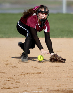 Sarah Nader - snader@shawmedia.com Prairie Ridge's Courtney Emricson fields a ball during the second inning of Monday's game against Cary-Grove on April 22, 2013. Cary-Grove won, 3-1.