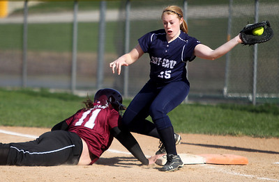Sarah Nader - snader@shawmedia.com Cary-Grove's Sarah Kendeigh (right) catches the pass after Prairie Ridge's Marissa Richter safely slides back to first base during the second inning of Monday's game in Cary on April 22, 2013. Cary-Grove won, 3-1.