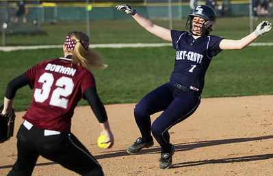Sarah Nader - snader@shawmedia.com Prairie Ridge's Claire Bowman (left) waits for Cary-Grove's Caitlyn Adams as she slides to third during the sixth inning of Monday's game in Cary on April 22, 2013. Cary-Grove won, 3-1.