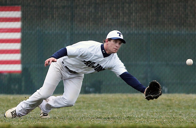 Sarah Nader - snader@shawmedia.com Cary-Grove's Zach Marszal dives for the ball during the second inning of Thursday's game against Woodstock North in Cary on April 11, 2013. Cary-Grove won, 11-1.