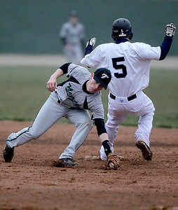 Sarah Nader - snader@shawmedia.com Cary-Grove's Ryan Dundon is safe at first while Woodstock North's Josh Neely grabs the ball during the fifth inning of Thursday's game in Cary on April 11, 2013. Cary-Grove won, 11-1.