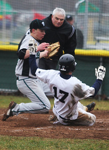 Sarah Nader - snader@shawmedia.com Cary-Grove's Zach Marszal safely slides to home while Woodstock North's Jamie Huntley runs after the ball during the third inning of Thursday's game in Cary on April 11, 2013. Cary-Grove won, 11-1.