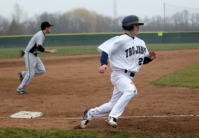 Sarah Nader - snader@shawmedia.com Cary-Grove's Matt Sutherland rounds third base during the second inning of Thursday's game against Woodstock North in Cary on April 11, 2013. Cary-Grove won, 11-1.