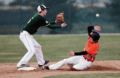 Sarah Nader - snader@shawmedia.com Crystal Lake South's Garrett Bright waits for the ball while Crystal Lake Central's Joey Ruffolo is out as he slides to third during t hr third inning of Tuesday's game in Crystal Lake on April 16, 2013. Crystal Lake South won, 8-0.